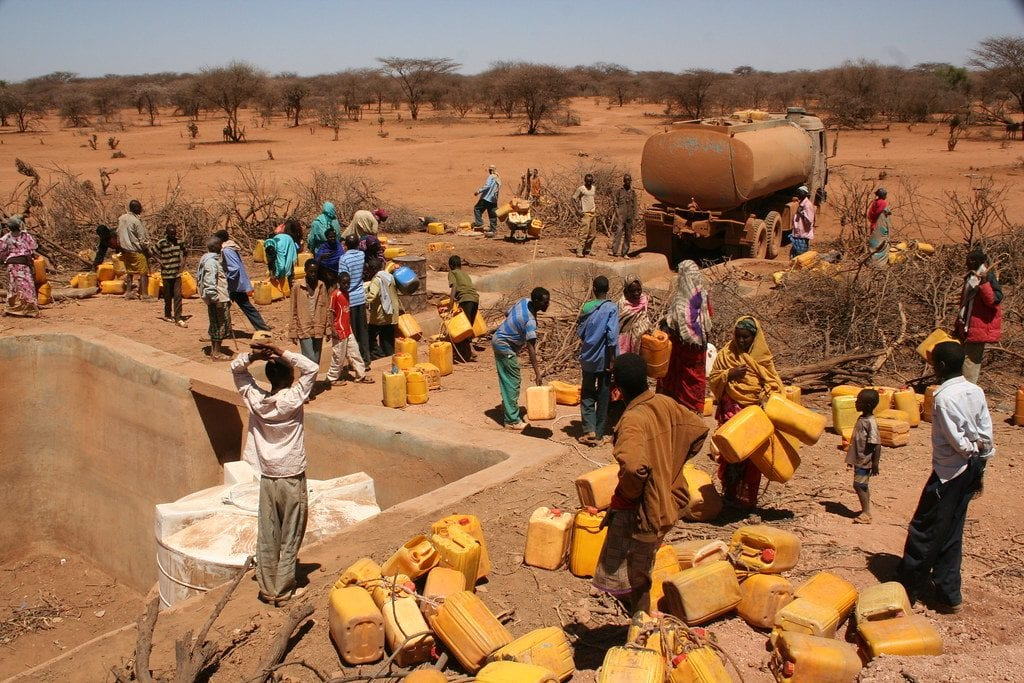 Queing for water from a truck in Ethiopia.